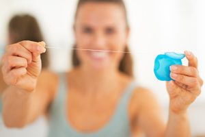 Using dental floss to make your mouth healthy. Billings dentist Cody Haslam shares why.